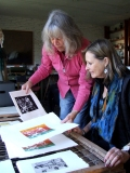 Maureen and Lorna, going over the solar-plate prints she made in Granada.