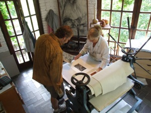 Lou Netter and Maureen Booth working together in her studio