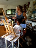 Claudio painting with his Nana
